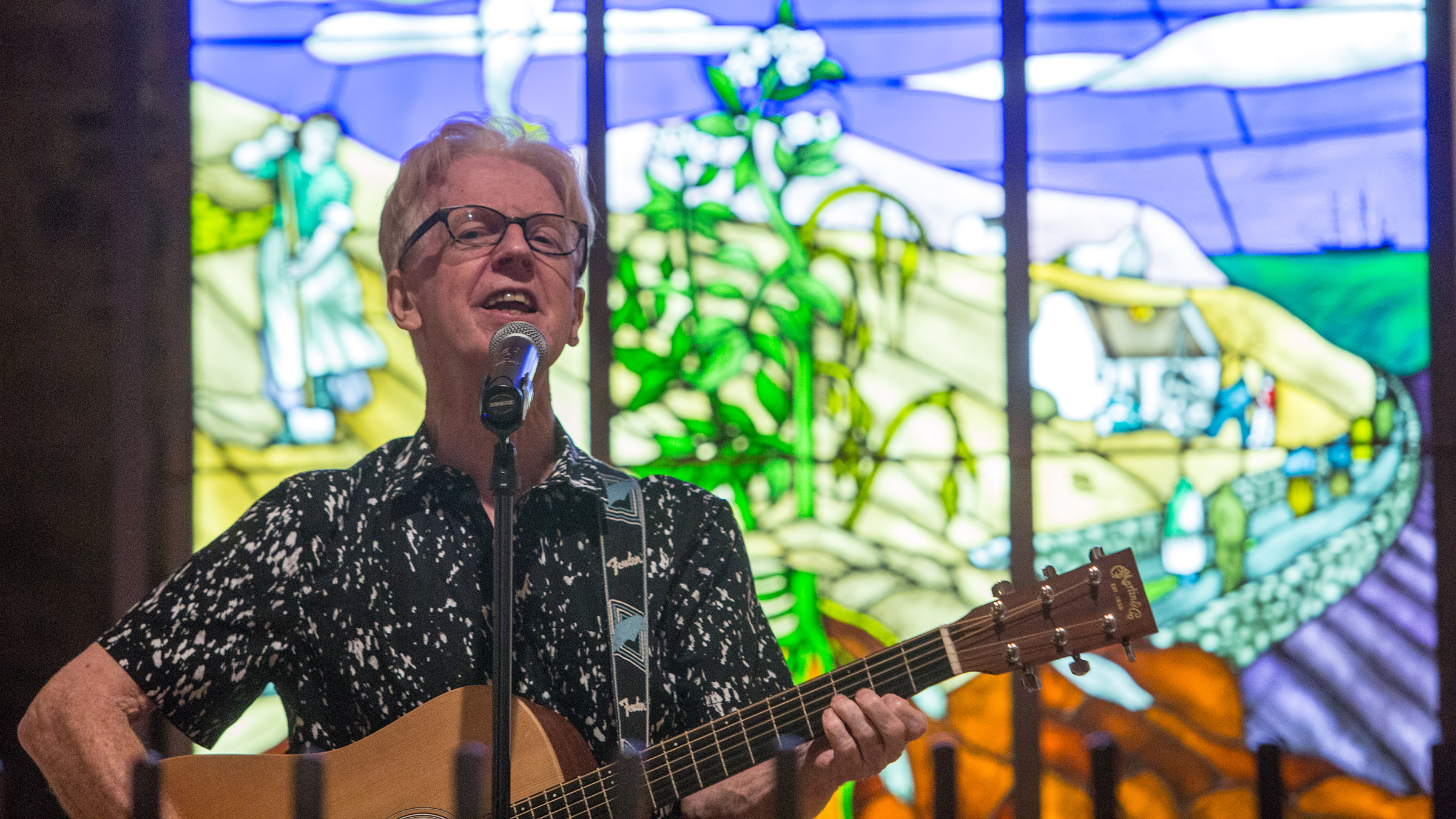 Larry Kirwin, a founding member of the Irish Musical group Black 47, performs his music and reads from his book at Ireland's Great Hunger Museum during the Rock and Read, a program that combines both music and literature, September 12, 2015 at the museum in Hamden, Conn. (For Quinnipiac University/ Michelle McLoughlin)