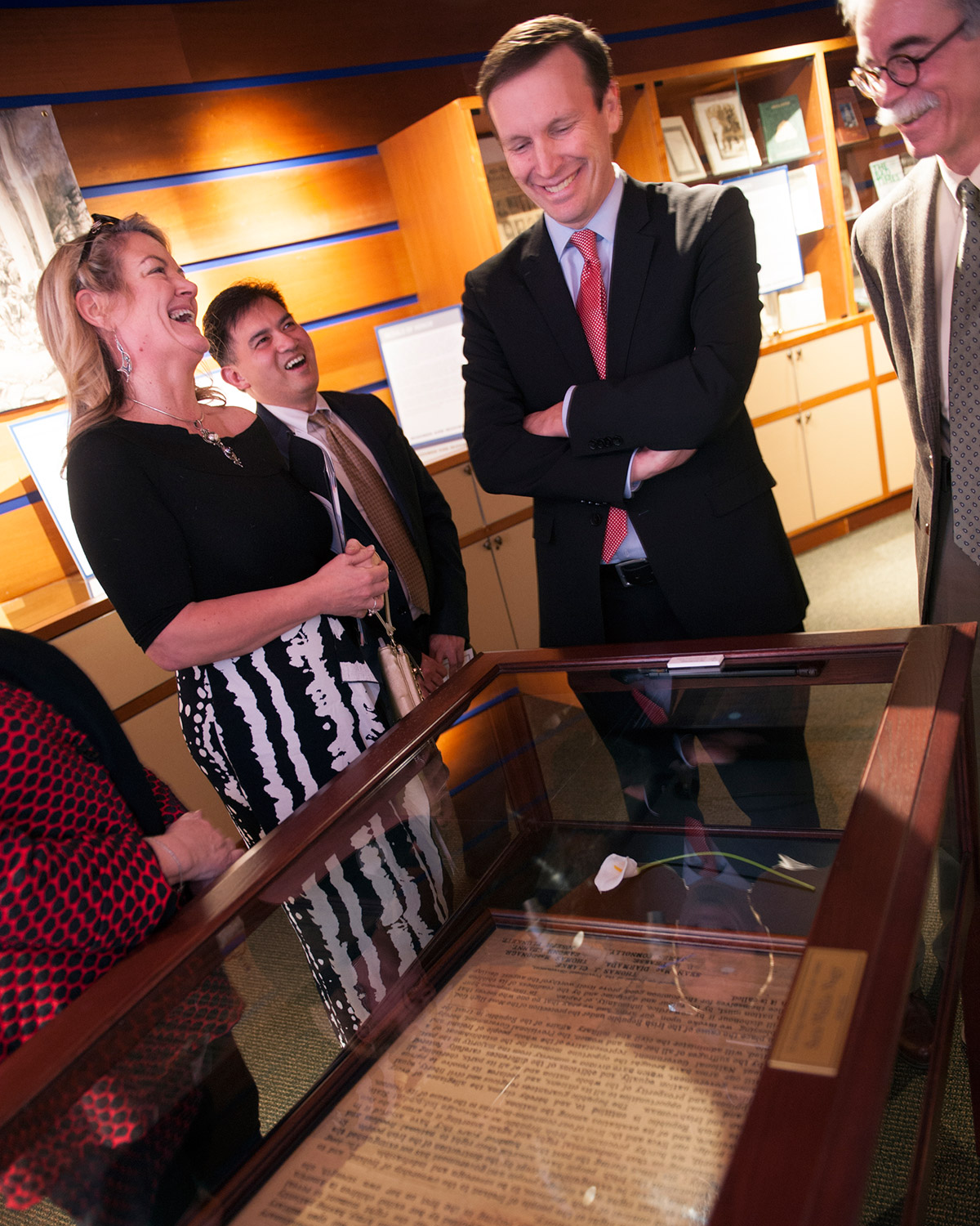 U.S. Senator Chris Murphy views an exhibition in the Lender Family Special Collection Room on the Mount Carmel Campus