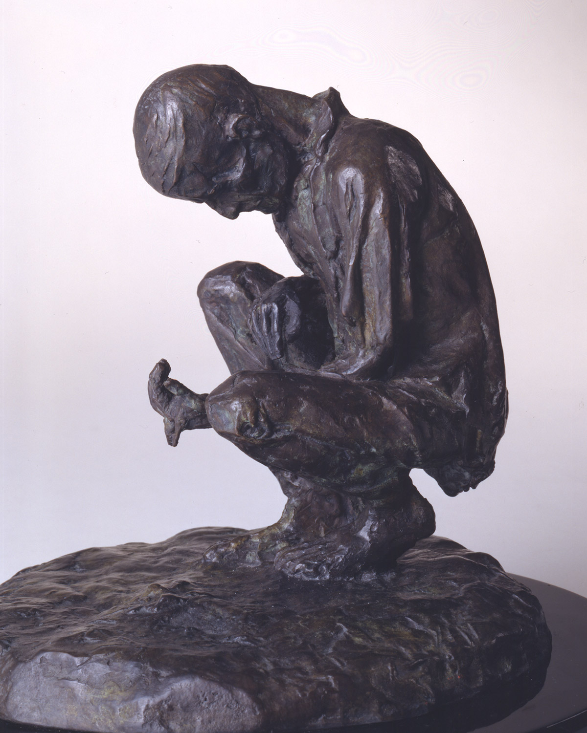 "A photo of a sculpture entitled ""Man Sifting Through Soil"" by the artist Margaret Lyster Chamberlain"
